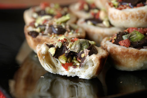 Chocolate Ganache Tartlettes with Pistachio and Goji Berry